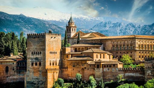 Visit Granada and see the Alhambra with snow-capped mountains behind