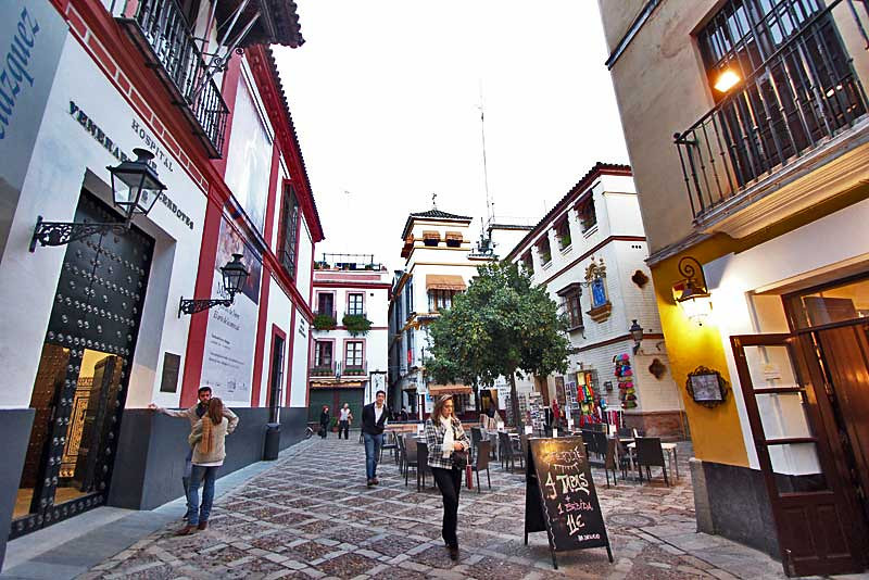 Travel to Seville and enjoy a coffee on one if the city plazas