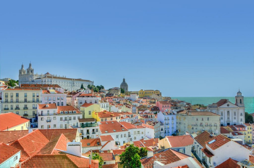 get a shuttle to the red roofs of Lisbon
