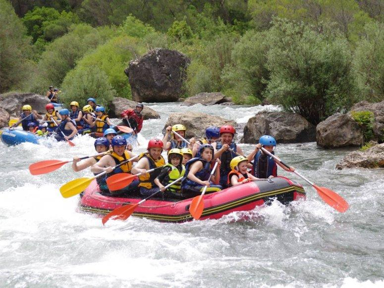 private transfer to Granada for rafting trip